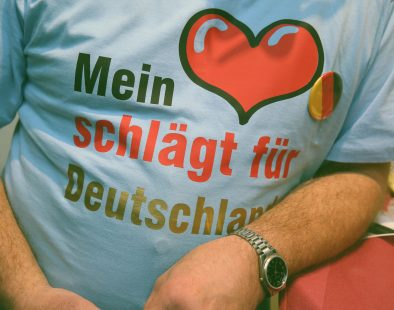 """MAGDEBURG, GERMANY - MARCH 11:  Supporters of the Alternative fuer Deutschland political party (Alternative for Germany, AfD), including one man wearing a t-shirt that reads: """"My heart beats for Germany,"""" attend the concluding AfD election rally in the state of Saxony-Anhalt on March 11, 2016 in Magdeburg, Germany. State elections scheduled for March 13 in three German states: Rhineland-Palatinate, Saxony-Anhalt and Baden-Wuerttemberg, will be a crucial test-case for German Chancellor and Chairwoman of the German Christian Democrats (CDU) Angela Merkel, who has come under increasing pressure over her liberal immigration policy towards migrants and refugees. The AfD, with campaign rhetoric aimed at Germans who are uneasy with so many newcomers, has solid polling numbers and will almost certainly win seats in all three state parliaments.  (Photo by Sean Gallup/Getty Images)"""